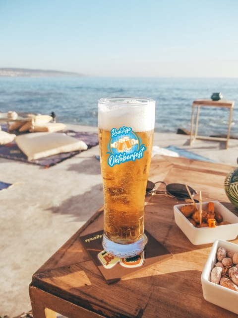 Redcliffe Marchtoberfest Beer with Ocean background